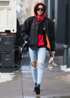 Browse the best street style looks from NYFW Fall 2017 via @STYLECASTER | distressed jeans over fishnet tights, sporty top layers