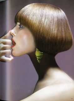 Justine with a Vidal Sassoon haircut and Don Berg for Tiffany's earrings. Photo by Hiro for Harper's Bazaar, August 1972.