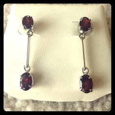 Genuine Silver and Garnet Earrings Dangling Rodium plated silver with genuine garnets. No scratches or dents. Never been used. Accessories