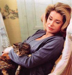 Catherine Deneuve and her feline friend.