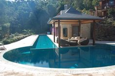 Clever, lap pool that spills to soaking pool. Hot tub on corner entrance by stairs Opulence - WyunaPools.com