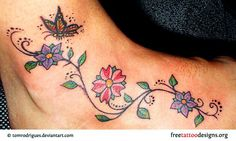 Butterfly tattoo and flowers on foot