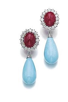 Pair of ruby, turquoise and diamond ear clips Each set with a cabochon ruby, within a border of brilliant-cut diamonds, suspending a turquoise drop, signed Bulgari.