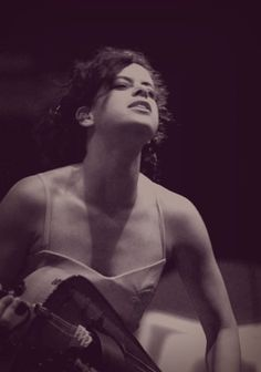 Regine Chassagne from the Arcade Fire. Spaghetti Strap Dress. Curly Updo