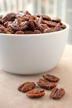 Candied Pecans  ngredients:  - 1 egg white  - 1/2 teaspoon vanilla extract  - 1/4 cup brown sugar  - 1/2 cup white sugar  - 2 tbsp cinnamon  - 1 tsp nutmeg  - 1 tsp salt  - 4-5 cups pecans