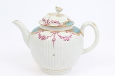 lot 192 18th century Worcester teapot and cover of ribbed form, with gilt floral swag and simulated shagreen decoration, with moulded flower-head knop, circa 1765 - 1770, approximately 17cm high