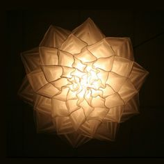 Shylight by Ralp Nauta and Lonneke Gordijn | It falls out of its cocoon', open its petals and floats down to show all its splendor. At the slightest hint of danger it flips up and retreats into its shell. |