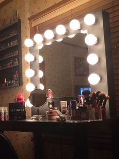 How to build a vanity mirror. PS, use Halogen lights, not the pictured ones because the ones photoed get super hot.