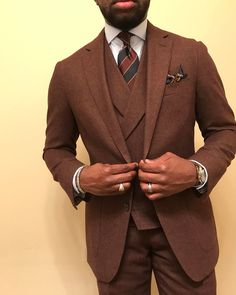 Classic striped tie paired with a chestnut brown suit.