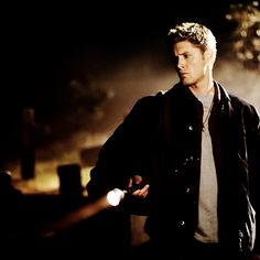 Dean, flashlight, grave yard