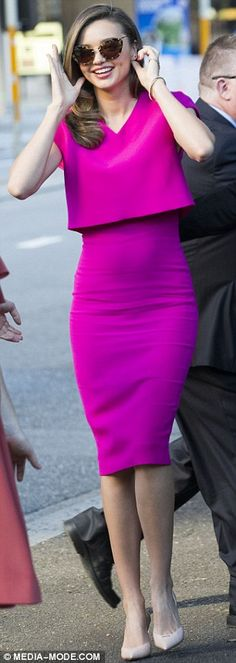 Quick change: For a consumer event held after the VIP soiree earlier in the day, Miranda changed into a fitted magenta dress with a cropped sheath on the top by British designer Victoria Beckham