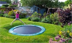 This in-ground trampoline is every child's dream! Create a warm fun and colourful environment for your family with fresh green turf and a thick collection of plants and flowers. In-ground trampolines are neat and fit seamlessly into your yard. They are without the hassle of needing to be moved so you can tend to your lawn and there is no risk of your child falling off! Any inquiries visit http://ift.tt/1bmneXB #gardenguys #landscaping#landscapingmelbourne #design #plants#ingroundtrampoline…