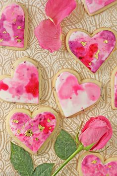 Watercolor Rose Sugar Cookies recipe from @elabau - It doesn't get much more girly than rose-flavored sugar cookies, containing bits of real rose petals, decorated with a pink and purple watercolor pattern and accented with sparkles of gold leaf.