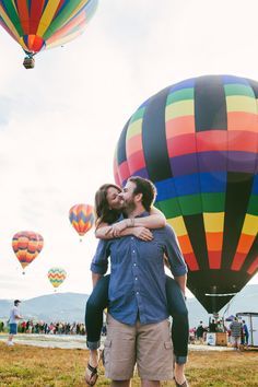 Engagement photo shoot with hot air balloons.