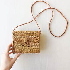 "* 100% handwoven rattan     * Leather strap     * 5"" x 6"" x 2.5"""