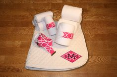 Fuchsia Quatrefoil Diamond Monogram Full Set, $85.00 by KLMequestrian.  Show off in this complete gift set for you and your horse! Customized with your monogram on the saddle pad.   1 Monogrammed saddle pad with diamond applique and lettering in thread color of your choice.   4 Standing wraps (horse or pony size), 4 Polo wraps (horse or pony size), 1 D-ring adjustable belt (adult or youth)