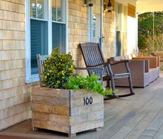 Add some color to your front door with a house number planter. Repurposing pallets into planters is a fun way to add a unique touch to your home!