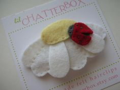Lady Bug on a Daisy wool felt hair clip 2 inch by lilchatterbox, $8.00