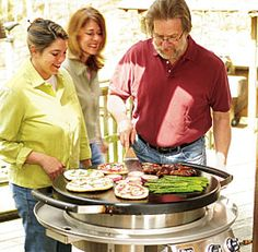 Charles Miller shows Fine Cooking staffers why he loves his Evo grill!