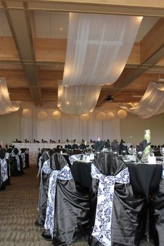 Ceiling drapery and tables in the Mountain Room for a wedding - Decor by First Comes Love Wedding & Event Design & Photo Booth Rentals