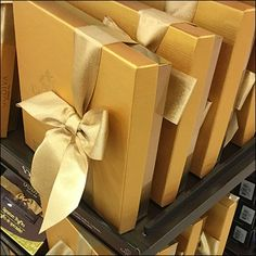 Nothing dresses up a box of fine Chocolate like a Ribbon and Bow. This Godiva Be-Ribboned Box Presentation takes the look to the max. Ribbon Box, Presentation, Gift Wrapping, Branding, Display, Store, Tableware, Candy Shop, Shops