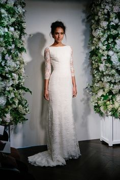 When The Morning Comes - Stewart Parvin. Photography by www.davidburkephotography.co.uk A silk crepe, softly fishtailed gown overlaid with Fonteyn lace featuring a boat neck and sheer, lace sleeves.