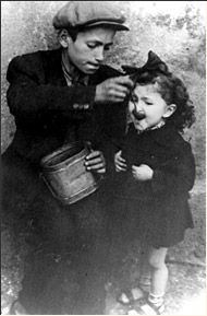 A Child Feeding his Sister, Lodz Ghetto, Poland.  (Many Polish-Jews from the Ghetto did not survive the Halocaust.