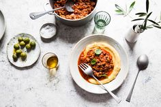 Polenta is a classic north Italian staple, typically served with rich hearty sauces such as ragù. I used to wake up on Sundays to my mum cooking polenta. It's not traditional to use pork sausage in ragù but it's delicious.