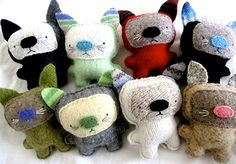 Artist Jennifer Syfu makes these cats out of old sweaters