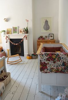I love that garland over the fireplace! I bet I can make one for Lily's room, and maybe even a mobile to go with it!