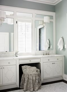 mirror trim details and the sconces over the mirror glass.  vanity details are nice, too.