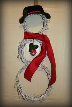 Wreath Snowman  - 99cent store craft- 3 different size grapevine wreaths, 1 roll ribbon, 1 foam hat (this was a cowboy hat, i just cut the brim), 1 pack of bells, i roll of twine (to tie the wreaths together) and a hot glue gun, very simple, cute gift. (you can even get the wreath hanger from the 99 cent store)