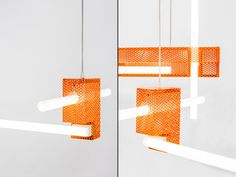 The lamps are positioned in such a way that they explore the X, Y and Z axes. We can consider them as rhythms that dynamize the space with its various volumes, thus enhancing the space sensation of the viewer.