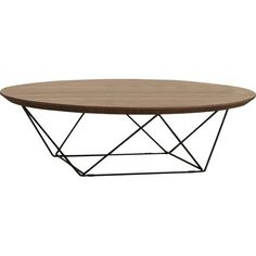 The geometric stainless steel legs create an airy yet sophisticated feel for this coffee table. The natural wood grain on the  circular top adds a soft texture, creating the ideal contrast to the sleek decorative metal legs.