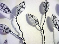 I like the elements of mixing wire or other materials and making use of the shadows.      shrinky dink trees!