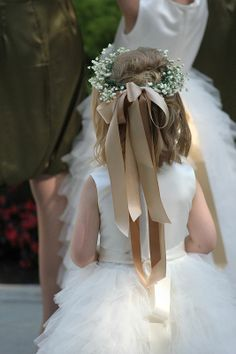 flower girl - maybe not as big a ribbon as this, but thought it looked cute :)