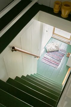 Narrow wooden stairs are painted in Benjamin Moore's Martha's Vineyard in An Artist's Cottage in Truro, MA, Gets an Overhaul from a Boston Design Duo (Ikea Included). Wood Floor Stairs, Painted Wooden Floors, Painted Floorboards, Painted Stairs, Wooden Stairs, Basement Staircase, Truro, Cottage Stairs, Stairs Colours
