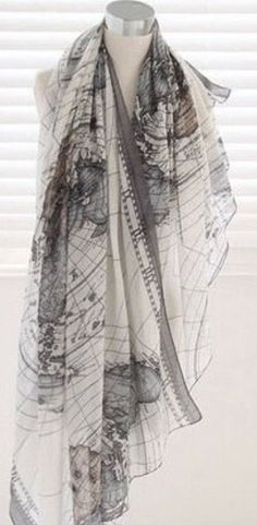 Ladies beautiful large world map print scarf. This scarf is light and soft may be worn as a beautiful scarf but very versatile and could also be worn