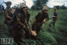 Marines recover a wounded brother while under fire in the DMZ - Jan 1966