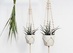 """Macrame Plant Hanger by MOX macrame Beautiful Macrame Plant Hanger, gentle and noble.100 handmade100 natural cotton cordTotal length: 122 cm (48"""")This hanger is quite flexible - designed for pots with a diameter 16-19 cm (6,3"""" ¨C 7,5¡¯¡¯) and a height of 15-19 cm (5,9¡¯¡¯- 7,5¡¯¡¯). Ready to ship in 5-6 working days.(Please note ¨C plant and pot not included in the offer)."""