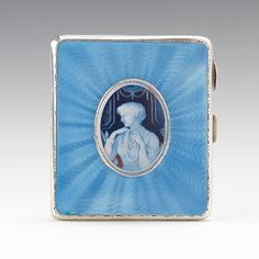 Sterling & Enamel Cigarette Case, English   Hallmarked case of sterling silver with interior gold wash, exterior with blue guilloche enamel and portrait image in oval mounting, mark of W.Neale & Son, Ltd., Birmingham. Engraved dedication