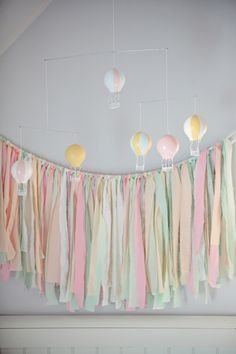 hot air balloon mobile + DIY pastel fabric strip garland. in more manly colors, of course :)