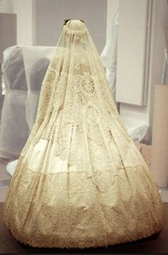 Back view of 1865 Wedding dress. Silk satin dress trimmed with Honiton appliqué lace, machine-net and bobbin lace. Worn at the wedding of Eliza Penelope Clay and Joseph Bright, St James's Church, Piccadilly, London, February 16, 1865.