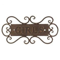 """Cast iron wall decor with a text motif and scrollwork accents.  Product: Wall decorConstruction Material: Cast ironColor: BrownDimensions: 4.25"""" H x 8.75"""" W x 1"""" D"""
