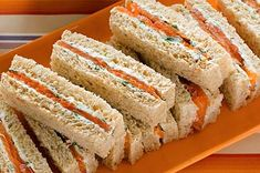 Salmon and herb cream finger sandwiches.