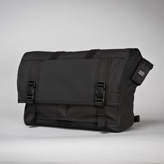 Mission Workshop - The Monty (Small) $149 Weatherproof Roll Top Messenger Bag The Monty is a 1,300 cu. in. weatherproof messenger bag featuring a roll top compartment along with two quick-access cargo pockets, two internal zippered pockets, custom aluminum hardware and a detachable cross-chest stabilizer. Fits up to 13'' laptop in front zip pocket and up to a 15'' in main compartment.  Made in the USA with a lifetime warranty.