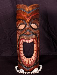 "Here is a hand carved Tiki mask with a beautiful finish. This lono mask - Tiki of Happiness was hand carved with great attention to details (ready to hang!). Measurement: 20"" by 6 inches Tiki: Happy T"