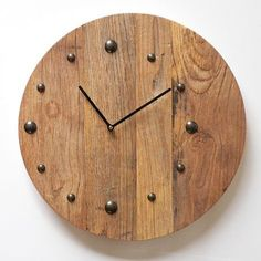 Wooden round clock. £70.99 http://www.worldstores.co.uk/p/Katigi_Reclaimed_Wooden_Round_Clock.htm