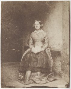 Portrait of a Lady, possibly a domestic servant, in a striped dress, late 1840s. Salted paper print from paper negative.