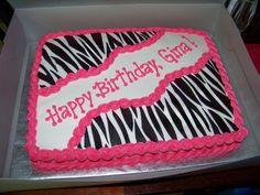 11 x 15 white sheet cake  with black fondant zebra stripes.
